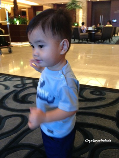 Baby walking at the lobby of Crimson Filinvest