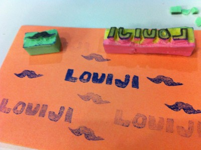 I chopped a big eraser to make mustache and LOUIJI stamps.