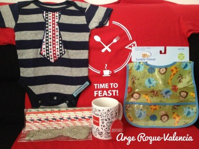 Red shirt from Zomato, green animal print bib from Luvable Friends, Zomato button pin, Zomato doodle mug, baker's twine and assorted paper straws from Paper Chic Studio and Little Man onesie from Silly Monkey Clothing